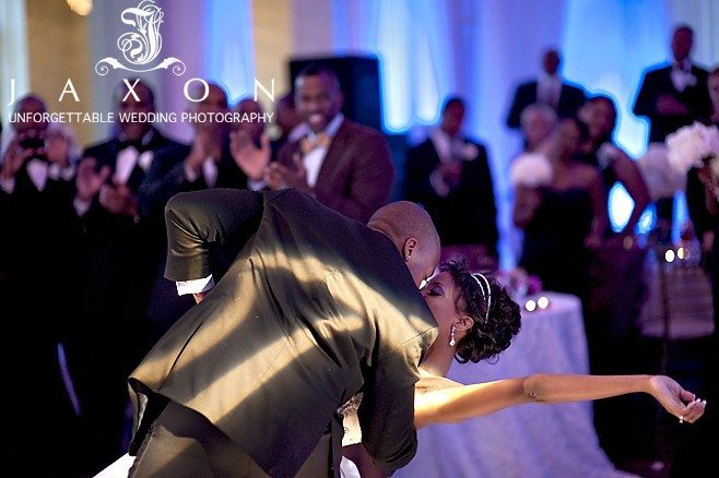 at the end of the couples first dance he dips her as guests cheer them on during their Biltmore wedding