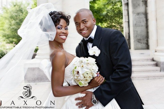 Brides veil flowing in the breeze in this portrait at the Carnegie Monument Atlanta | Biltmore Ballrooms Real Wedding