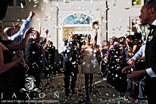 As the couple leaves the Biltmore wedding, they are showered with white rose petals by their guests