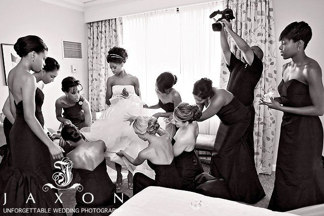 Final preparations bridal party helping bride | Biltmore Ballrooms Real Wedding