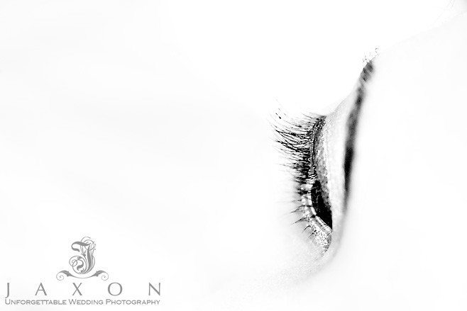 an artistic black and white closeup photograph of brides eye after make up