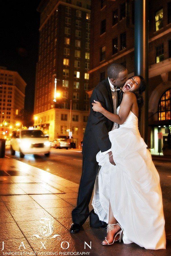 Bride screams in delight on Peachtree street outside the Ritz Carlton Atlanta