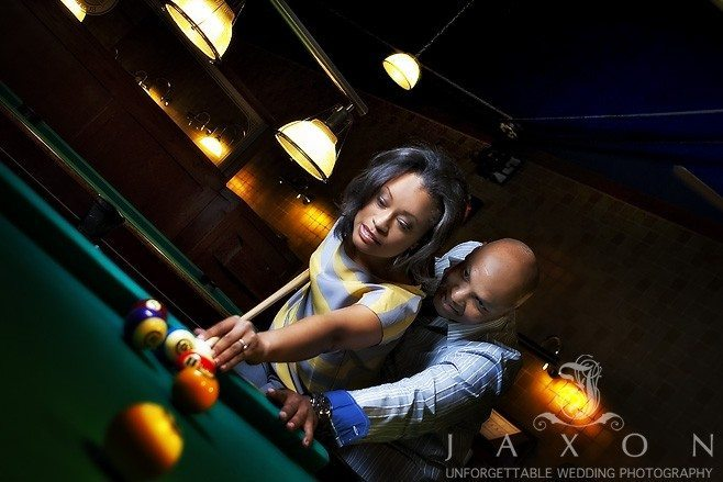 Billiards at Dave and Busters during engagement session