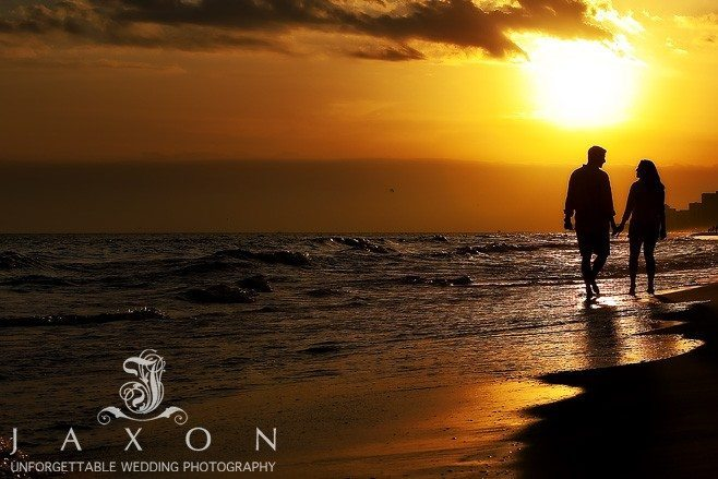 couple Walking on the beach in a golden sunset