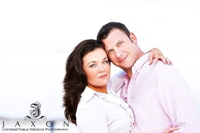 Beautiful closeup portrait of couple in white and pink tops