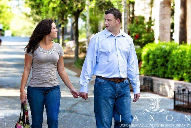 Couple strolls hand in hand in the Sandestin Golf Resort
