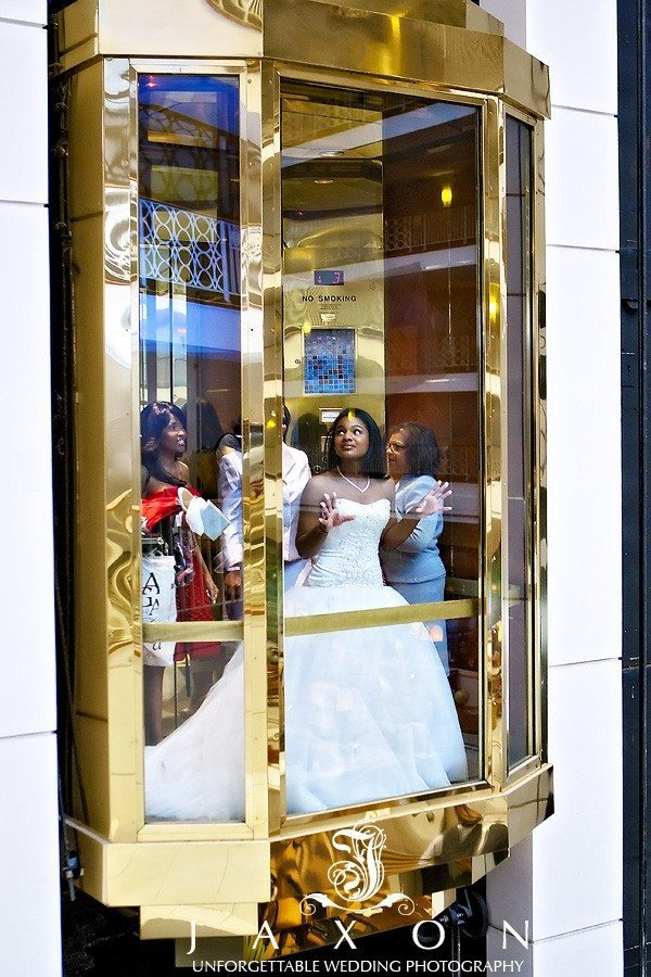 Bride and wedding party take a ride on the elevator to wedding ceremony