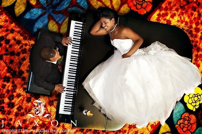 Groom plays on the baby grand at Renaissance Concourse Hotel wedding