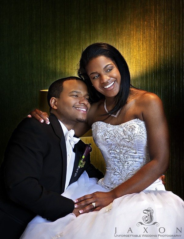 Couple embraces at their wedding Reception