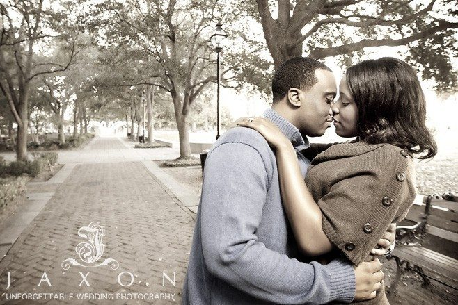 Couple in romantic embrace during their engagement session