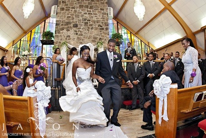Bride and groom jumps the broom after their wedding ceremony at Greater Community COGIC in Marietta | Olde Towne Club Wedding