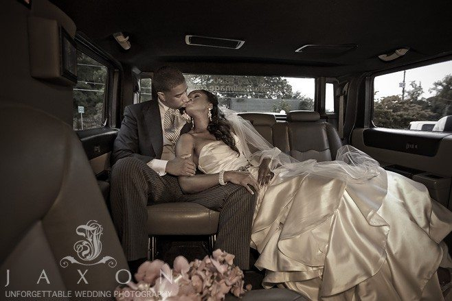 Bride and groom relaxes in their limousine after their wedding ceremony at Greater Community COGIC in Marietta | Olde Towne Club Wedding