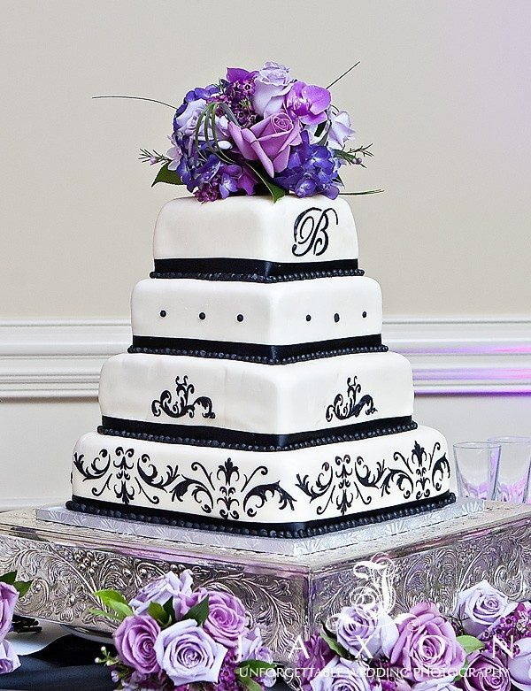 Black and white Four tiered square wedding cake topped with purple and lavender floral arrangement | Olde Towne Club Wedding
