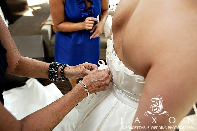 Bride's mom zips her wedding gown as she readies for her Peachtree Club ceremony | Peachtree Club Roof top Weddings