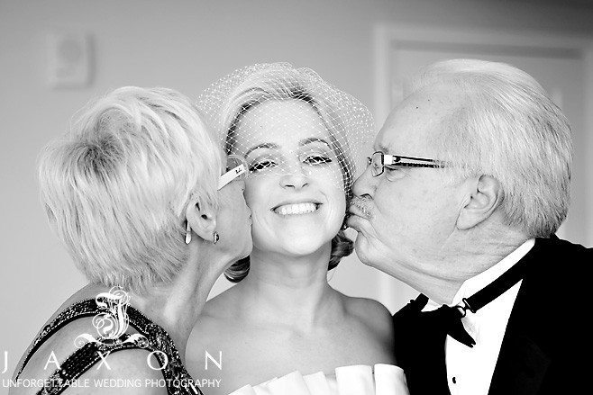 One last kiss from the parents, Peachtree Club | Peachtree Club Roof top Weddings