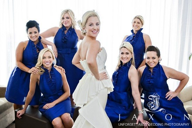 Bride and Party in navy blue at Loews suite before her Peachtree club rooftop Wedding