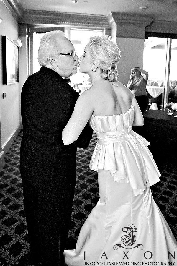 Bride kisses her dad just before he walks her into her rooftop wedding ceremony | Peachtree Club Roof top Weddings
