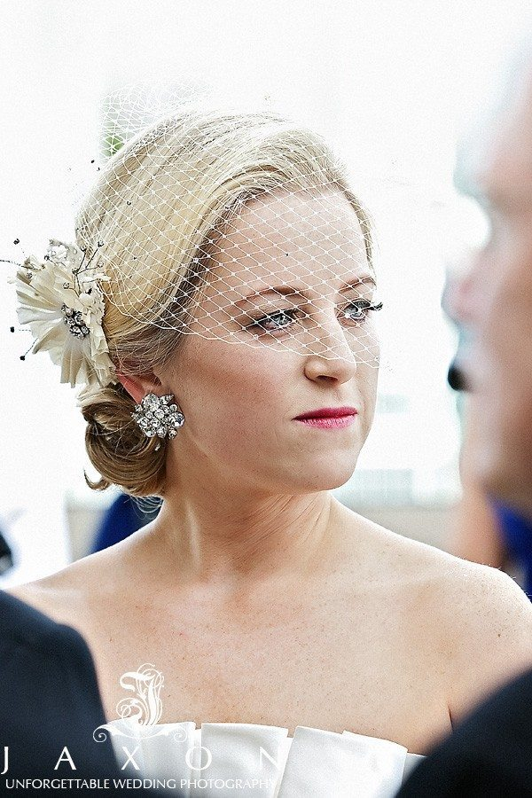 An attentive Bride at the Peachtree Club Wedding | Peachtree Club Rooftop Wedding