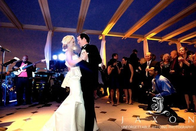 First dance on the rooftop at twilight against a beautiful purple sky | Peachtree Club Roof top Weddings