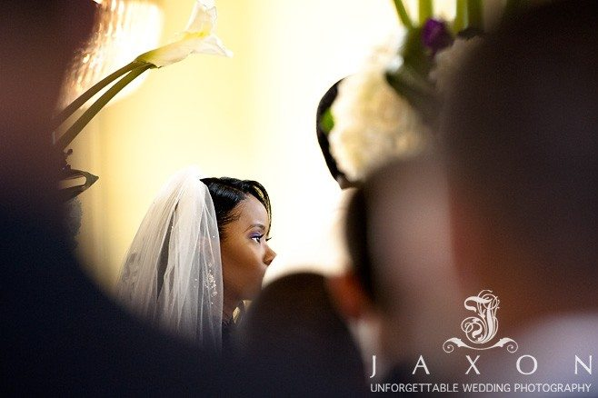 Bride listens intently to vows at Biltmore Ballrooms | Aaliyah