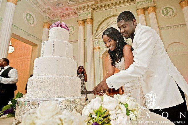 Couple cuts the wedding cake Biltmore Ballrooms