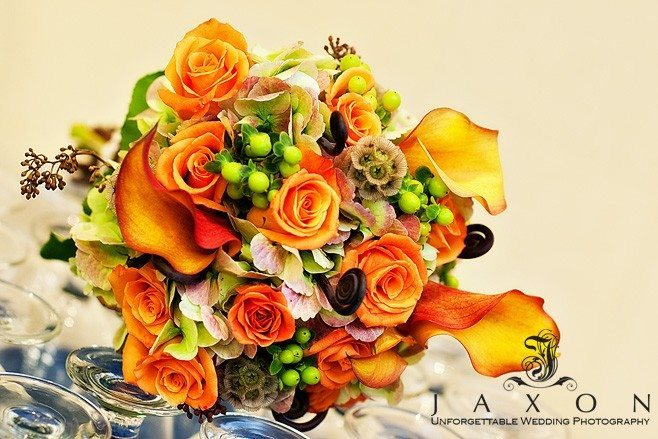 Bridal bouquet of orange roses and calla lilies