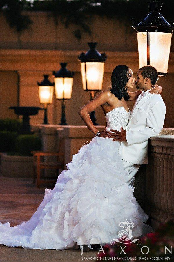 Couple in a romantic embrace in courtyard of St. Regis Atlanta