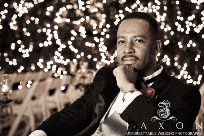 Groom poses in the gardens for this night time photo | Flint Hill Wedding