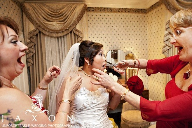 Flint Hill Wedding | brides attendant pretends to clip the brides curls