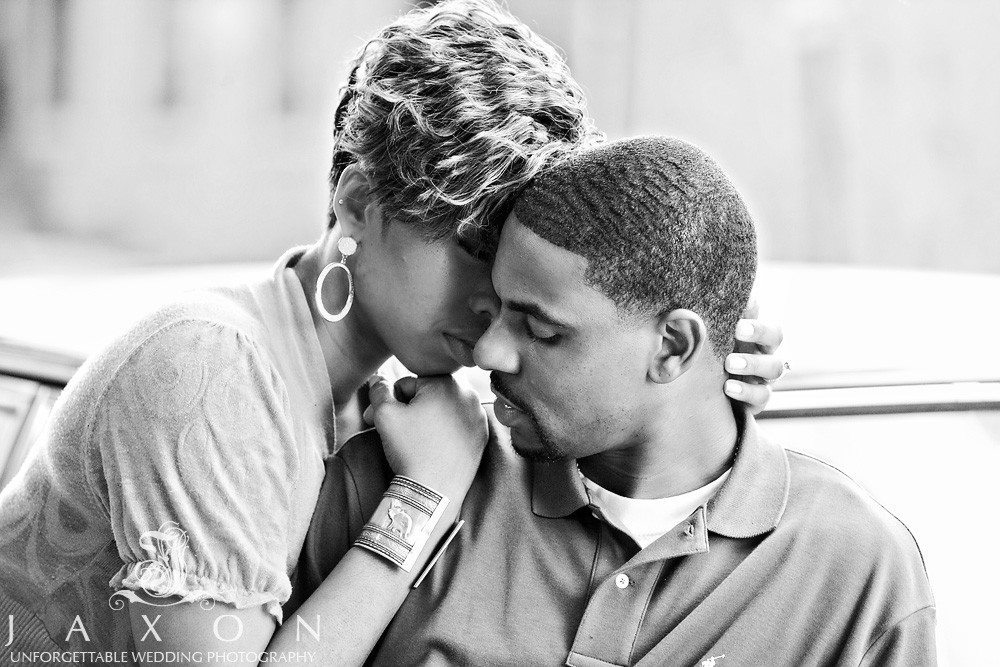 A b&w photo of a tender embrace during their engagement session
