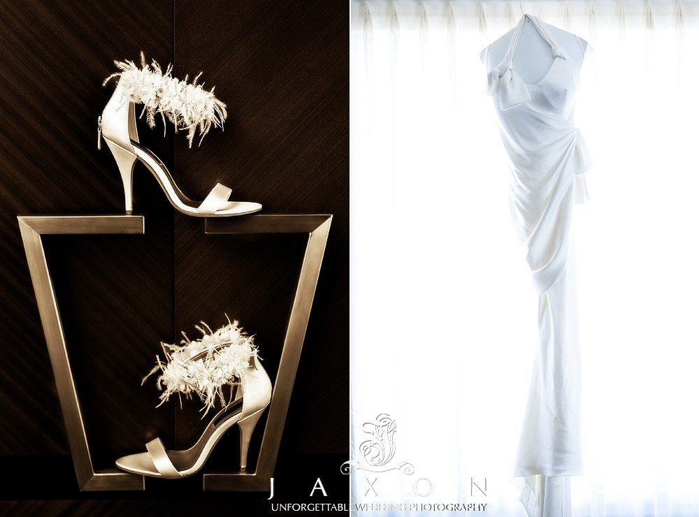The brides shoes showcased on closet handles and wedding dress hangs in the window