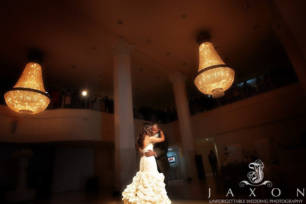 Amid the towering columns and opulent chandeliers the couple had their first dance in the Grand Atrium at 200 Peachtree Wedding in Atlanta