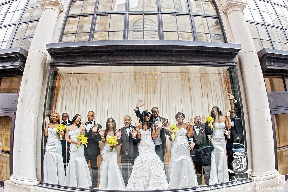 Wedding party strike a pose in the window at 200 Peachtree in downtown Atlanta