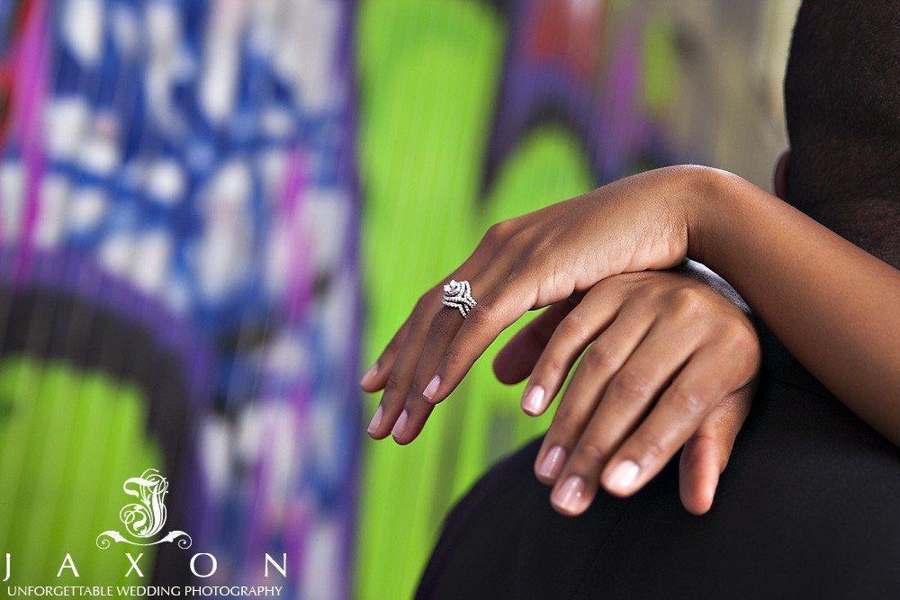 Atlanta GA weddings rings against graffiti background