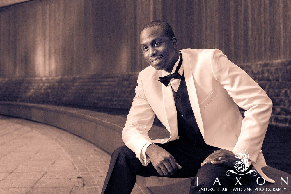 Groom relaxes for a portrait at Woodruff Park in downtown Atlanta after his wedding, by Atlanta wedding photographers