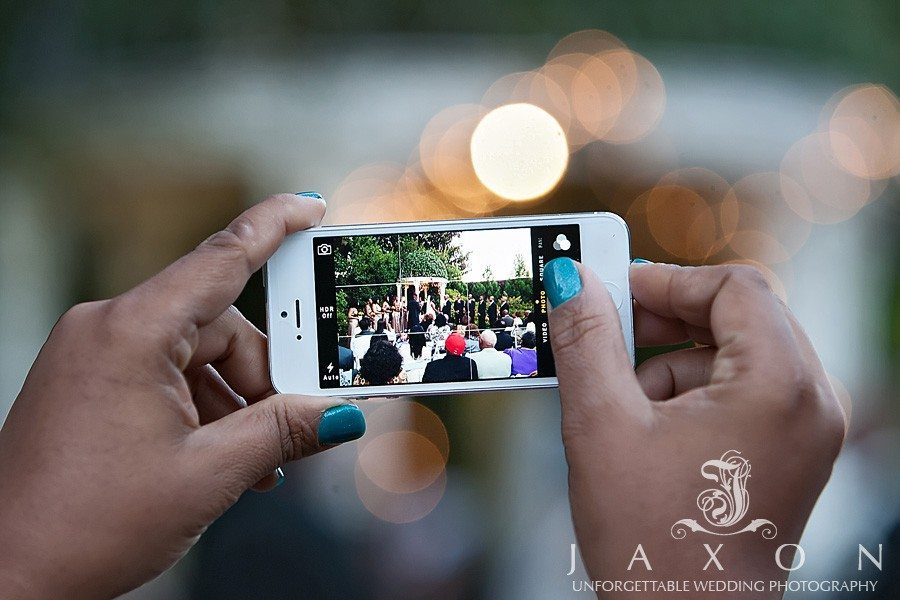 a photograph of A guest I phone picture of the proceedings | atrium wedding