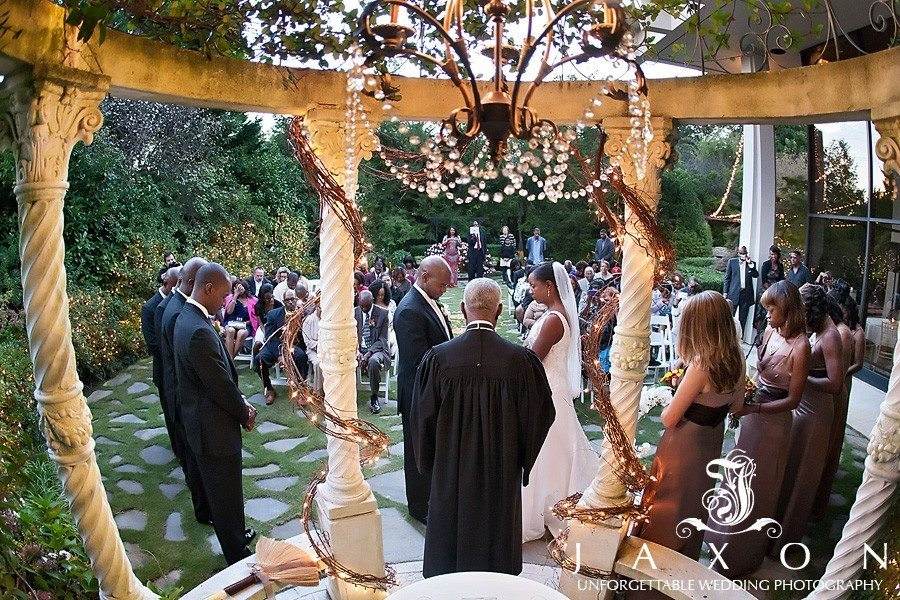 Beautiful wide angle photograph from inside the gazebo looking out at the guests assembled in the gardens | atrium norcross wedding