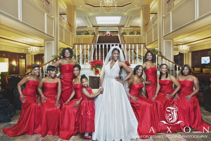 Bride and her party of 9 in strapless floor length burgundy dress in the lobby of the Augusta Marriott at the Convention Center