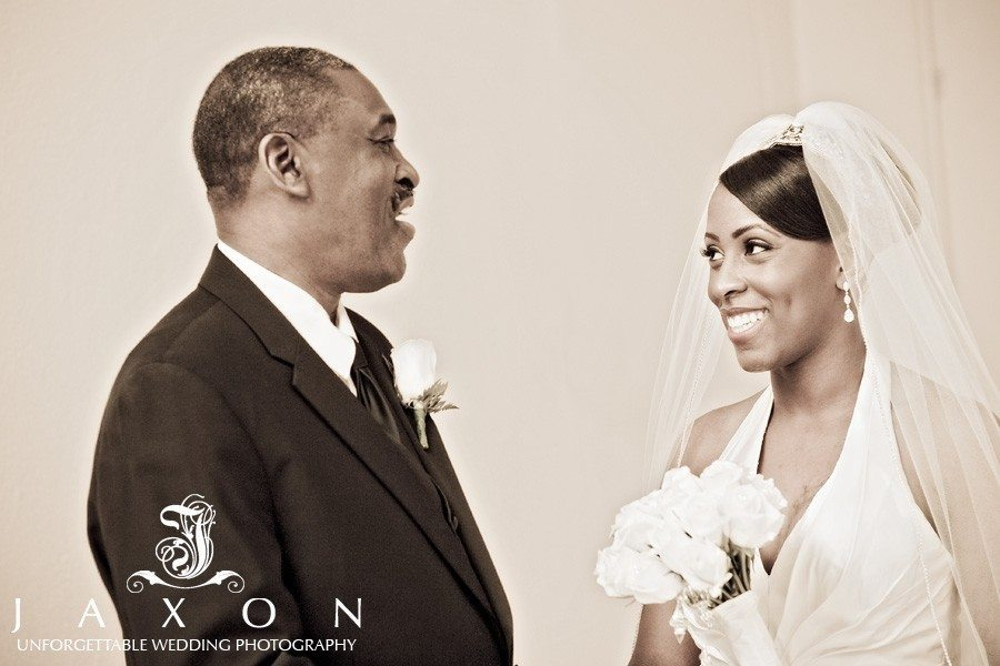 ride and dad shares a laugh before her wedding ceremony at Tabernacle Baptist
