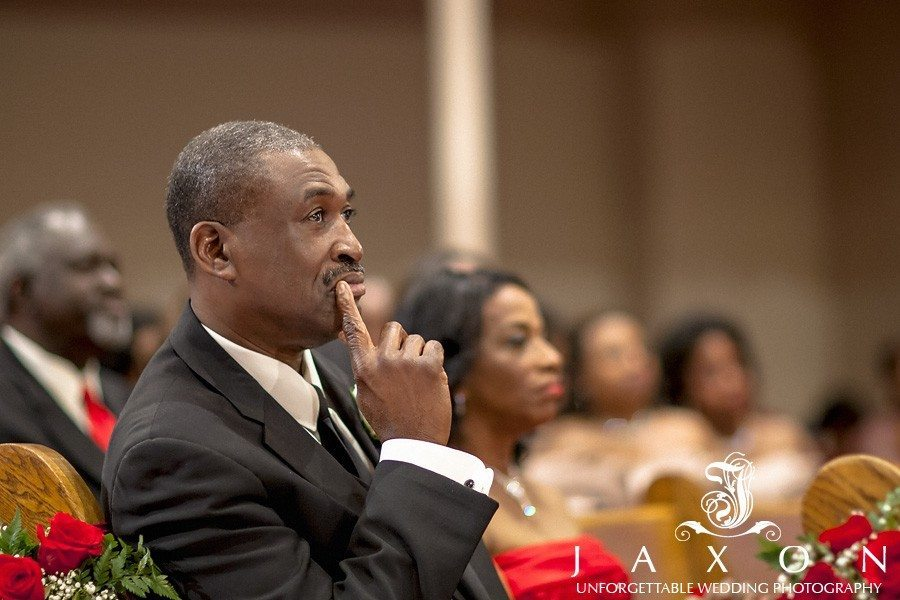 Father of the bride paying close attention to wedding proceedings