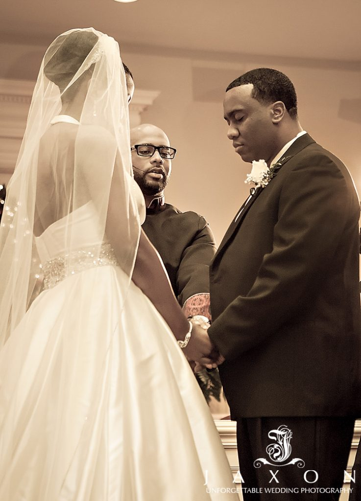 inister blesses newly married couple at their Tabernacle Baptist Church wedding