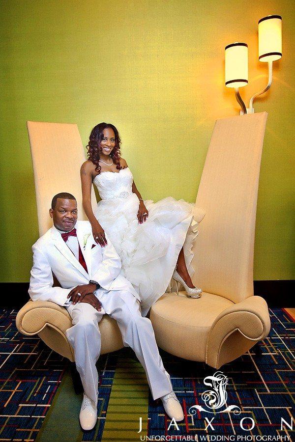 Bride and groom on fancy chair at Marriott Gateway Atlanta wedding