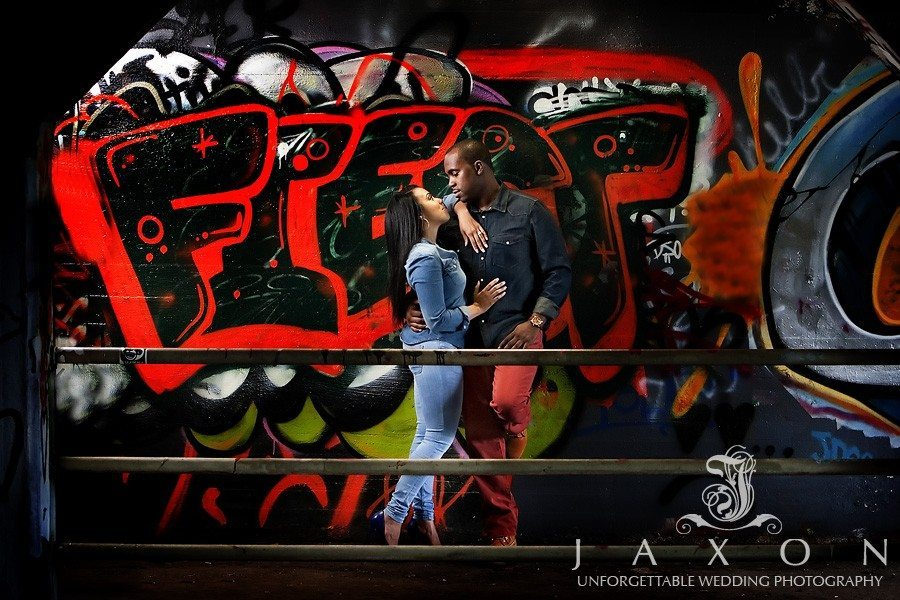 Couples pictures in Krog Street Tunnel with colorful graffiti in background