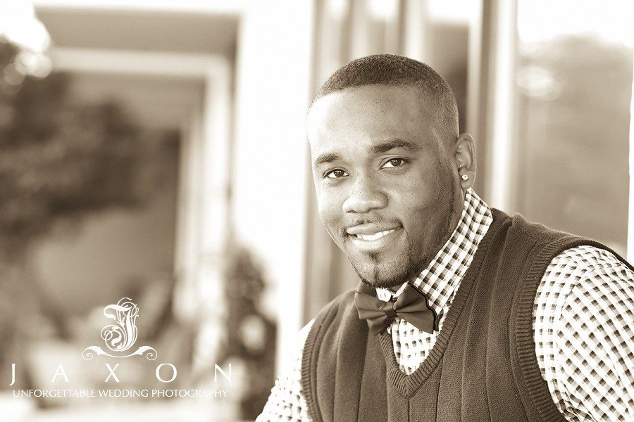 Sepia toned portrait of fiancé with sweater vest and bow tie