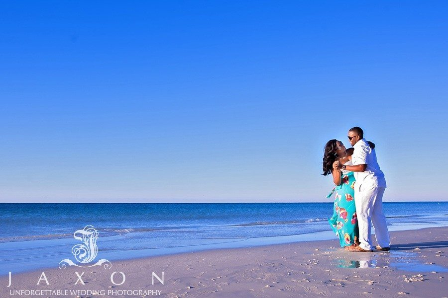 Couple dances on the beach in Destin FL during their engagement session