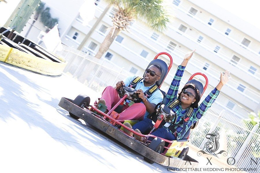 Engaged couple having some fun in Go-racing cart during engagement photography session