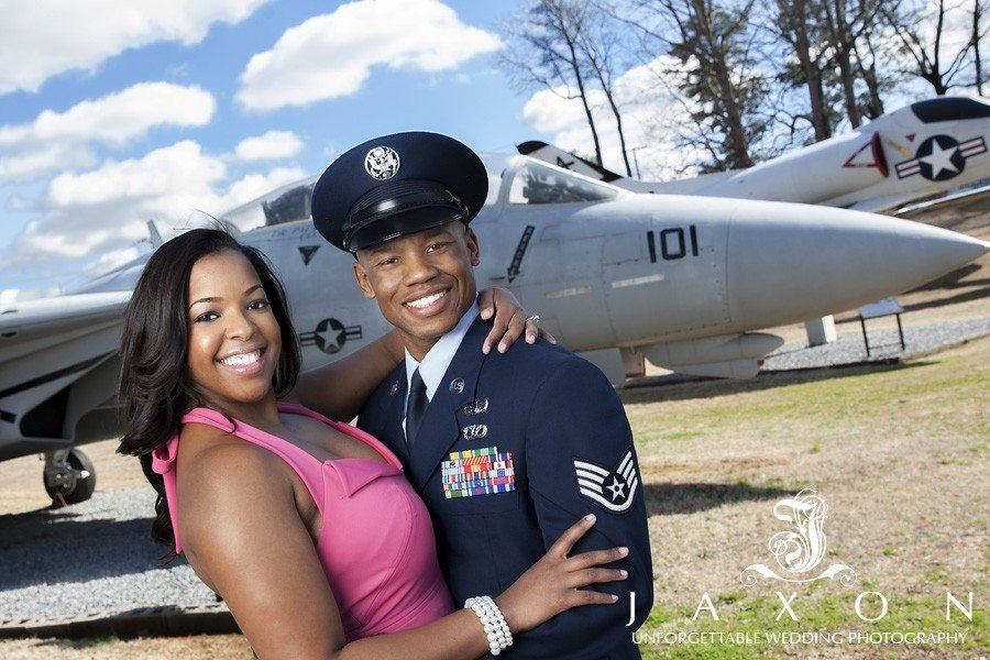 Airfore EOD in dress blues and his bride to be with Air Force jets as a back drop