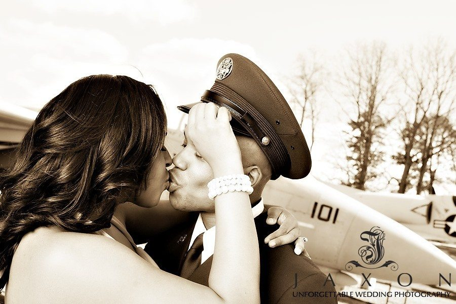 Airfore EOD in dress blues kisses his bride to be with Air Force jets as a back drop