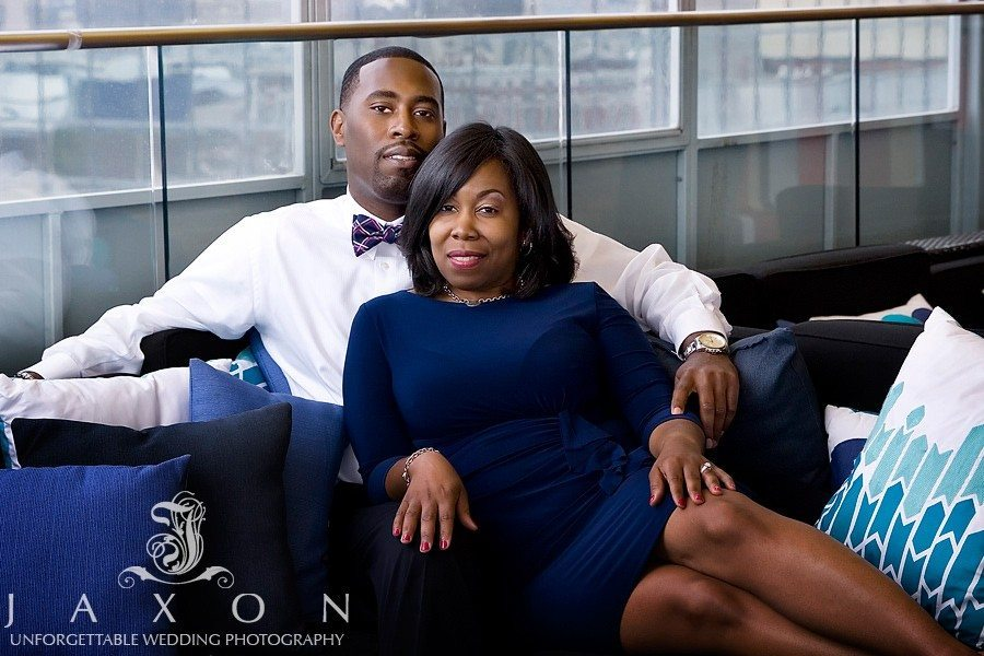 Couple on the rooftop lounge during their Glenn Hotel Engagement Session