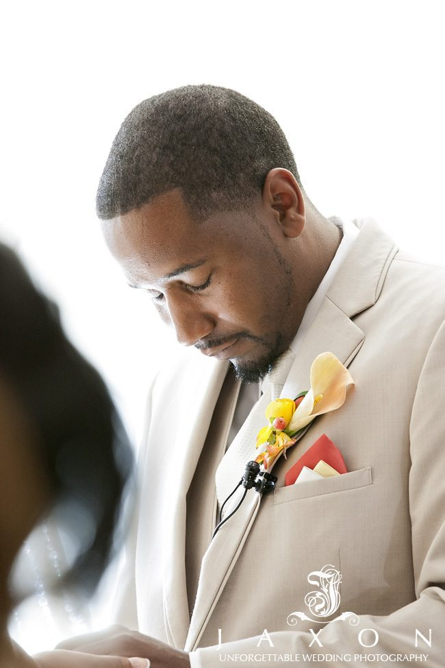 Groom with head bowed during wedding ceremony prayer